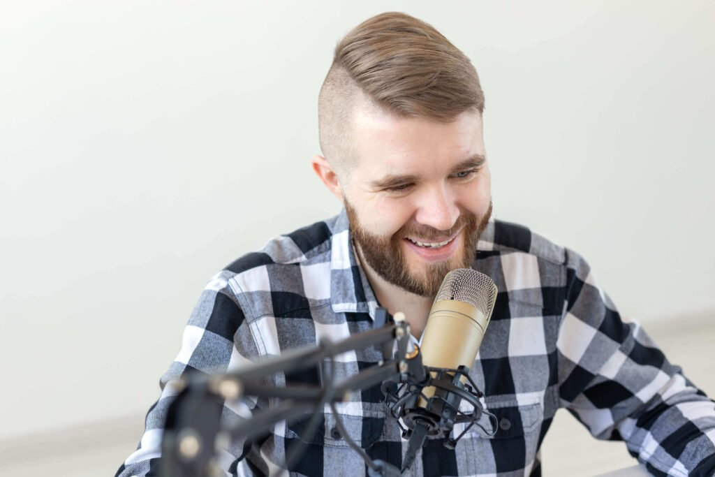 Male Podcaster taking the Podcast Moneymaker Course